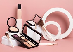 Make up products prsented on white podiums on pink pastel background. Mockup for branding and packaging presentation