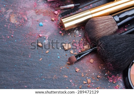 make up set, soft  makeup  brushes and  maskara on black background