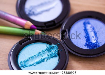 make-up shot of some blue eyeshadows and eye liners/pencils