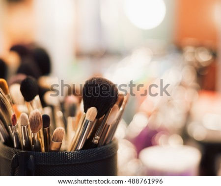 Make up table in beauty salon.Set of professional brushes for makeup.Make up beauty salon equipment for visage.Face makeup artist brush tool kit bag.Visagiste studio equipment for facial beauty visage