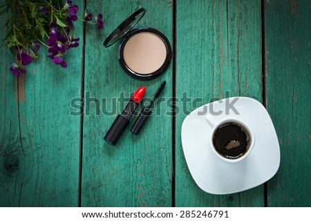 Make-up tools and morning cup of coffee, every day girls routine concept