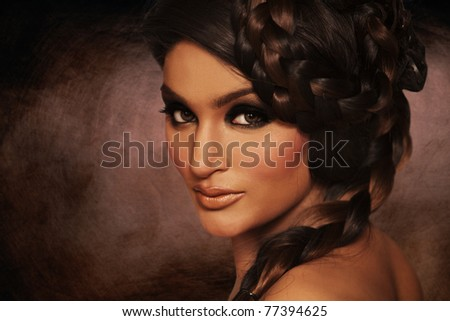 make-up with stylish hairstyle. Close-up portrait of young beautiful indian woman.