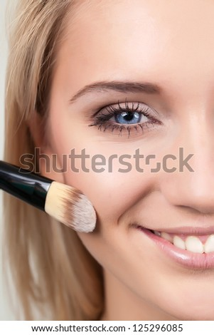 make-up woman with makeup brushe