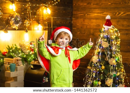 Make wish. Best wishes for you your family this christmas. Merry christmas and happy new year. Cute boy play near christmas tree. Kid enjoy winter holiday at home. Home filled with joy and love.