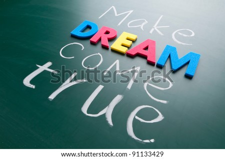 Make your dream come true. Colorful words on blackboard. - stock photo