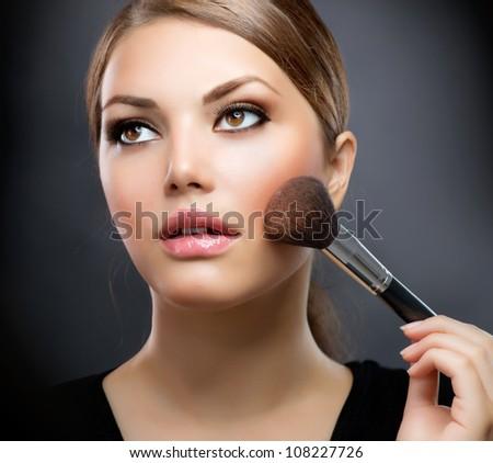 Makeup. Applying Make-up Cosmetics Brush. Perfect Make-up.