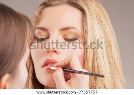 Makeup Artist Doing Lips