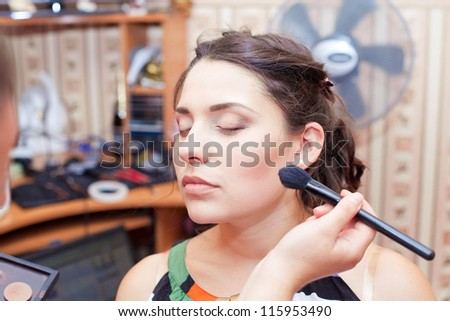 Makeup artist doing makeup - stock photo