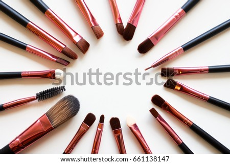 makeup brush/ A makeup brush is a tool with bristles, used for the application of make up or face  #661138147