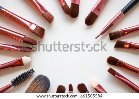 makeup brush/ A makeup brush is a tool with bristles, used for the application of make up or face  #661505584