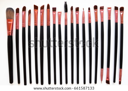 makeup brush/ A makeup brush is a tool with bristles, used for the application of make up or face  #661587133