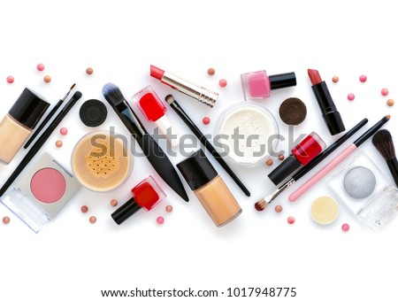 Makeup brush and decorative cosmetics on a white background. Top view #1017948775