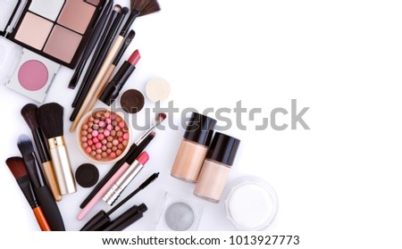 Makeup brush and decorative cosmetics on a white background with empty space. Top view