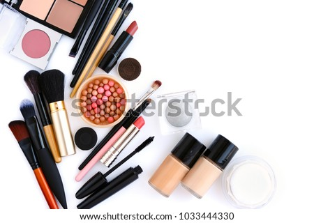 Makeup brush and decorative cosmetics on a white background with empty space. Top view #1033444330