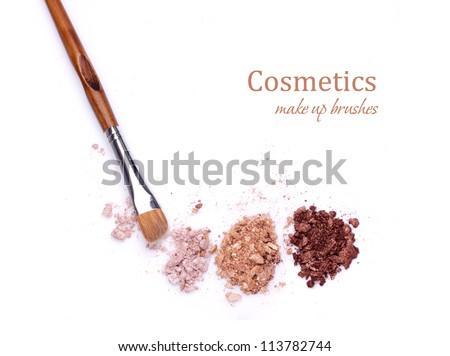 makeup brush and multicolored eye shadows isolated on white background