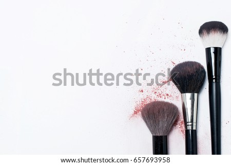Makeup brush with the remnants of the blush and powder #657693958