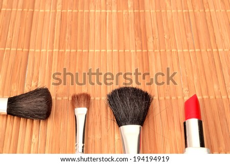 Makeup brushes and lipstick