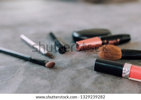 Makeup brushes and tools on desk. #1329239282