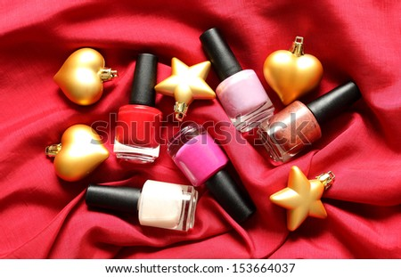 Makeup, Christmas or New Year party - nail polish on red silk