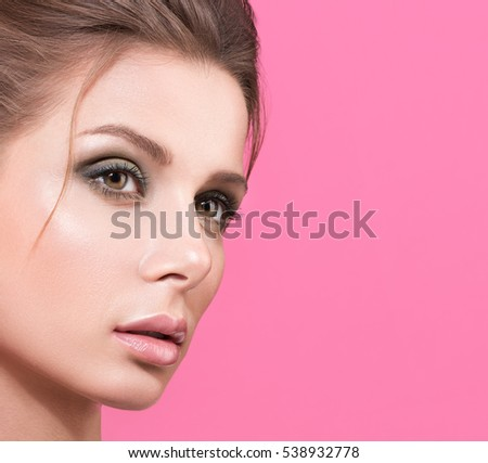 Photo of Makeup closeup of young beautiful woman on pink background. Image with free space