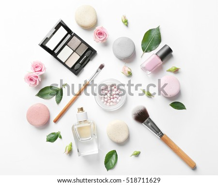 Makeup cosmetic with macaroons and beautiful flowers on white background stock photo