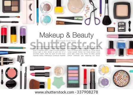 makeup cosmetics and brushes on white background