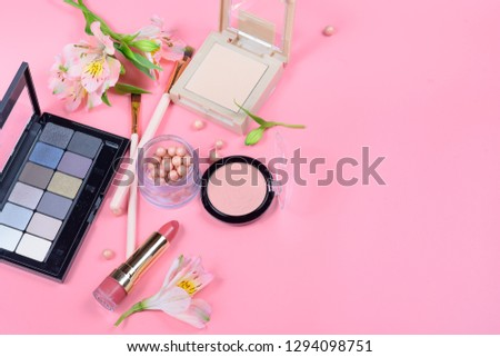 Makeup cosmetics and flowers on pink background. Top view.  #1294098751