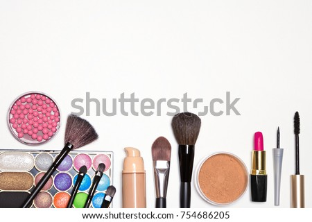 Shutterstock Makeup cosmetics background. Bright holiday make-up essentials. Free space for text
