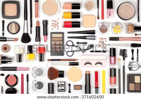 makeup cosmetics, brushes and other essentials on white background top view. beauty flat lay concept