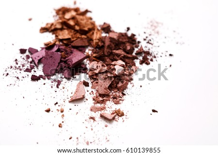 Makeup cosmetics. Eyeshadow crushed palette, colorful eye shadow powder on white background #610139855