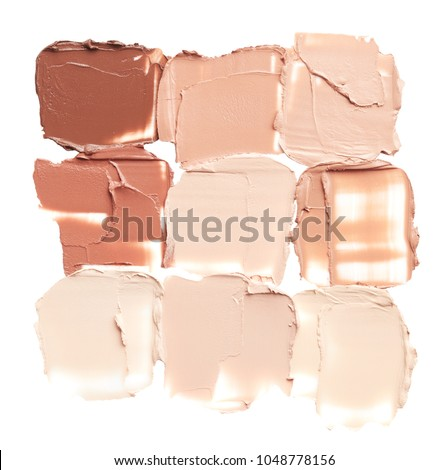 Makeup foundation smudges isolated on white background #1048778156