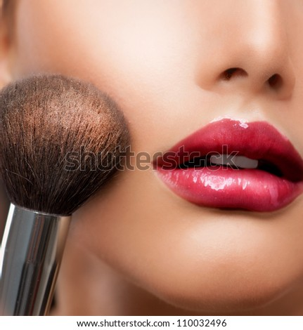 Makeup. Make-up closeup. Cosmetic Powder Brush.Perfect Skin - stock photo