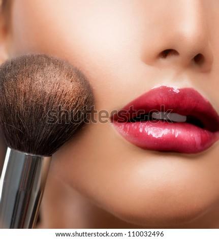 Makeup. Make-up closeup. Cosmetic Powder Brush.Perfect Skin