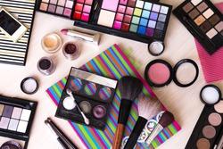 makeup maquillage kit (set): palette, brush, eye shadow, powder, lipstick (flat lay)