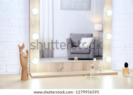 Makeup mirror on table near white wall in dressing room ストックフォト ©