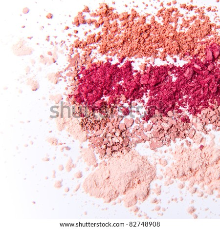 makeup powder in three colors on white background