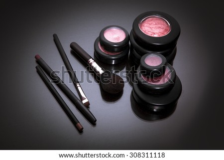 Makeup products on dark background with copy space for your text. studio shot. Horizontal picture