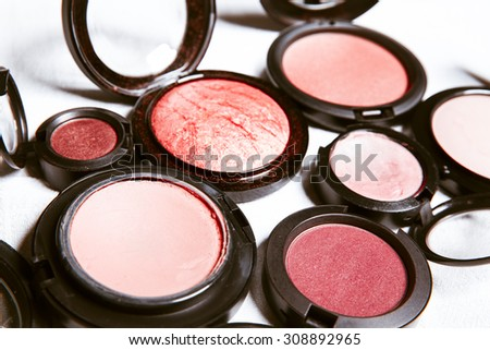Makeup products on white background with copy space for your text. Studio shot. Horizontal picture.