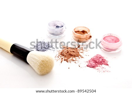 makeup set and brush on white background