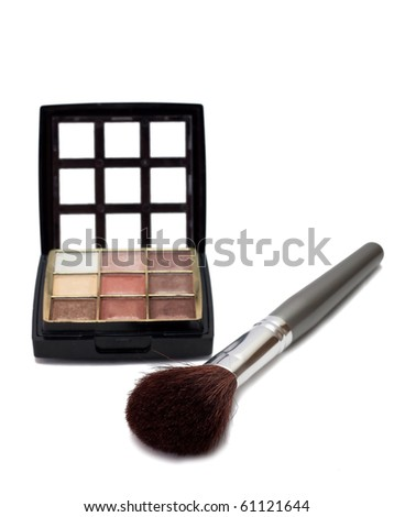 Makeup set with brushes and eye shadows isolated on white