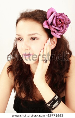Makeup shot with beautiful girl with beautiful eyes and lips and flower
