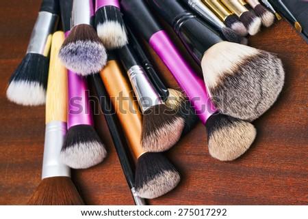 Makeup tools, brushes and eye shadows