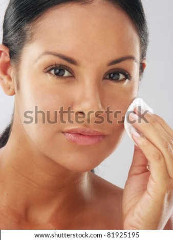 Makeup young beautiful woman after bath - spa cleaning her face