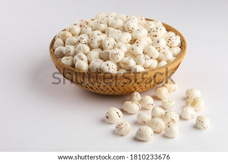 Makhana chiwda or Foxnuts, peanuts and chanadal mixture with two mugs of tea. Makhana or fox nuts are healthy snack having high nutritional value are native to South Asia, Punjab, Bihar
