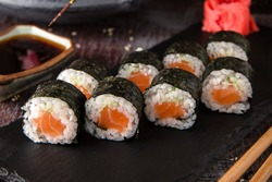 Maki rolls with salmon and cheese. Sushi menu. Japanese food.