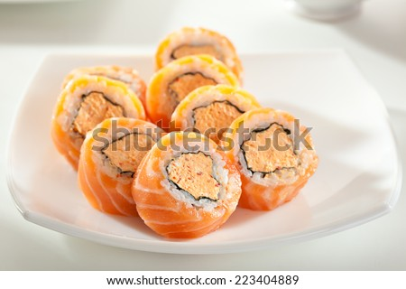 Maki Sushi - Philadelphia Roll made of Spicy Cream Cheese  inside. Fresh Raw Salmon outside