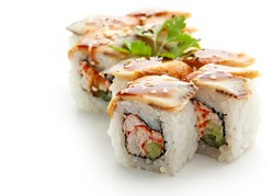 Maki Sushi with Crab Meat - Roll made of Crab Meat, Cucumber and Tobiko inside. Topped with Eel