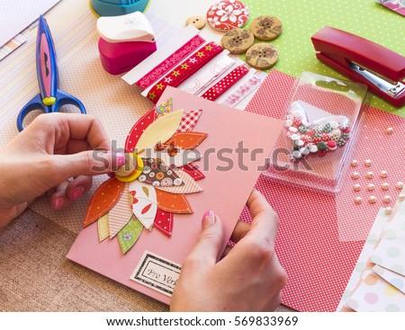 Shutterstock Making a scrap booking birthday card/Scrapbook, Button, Craft, Adult, Art