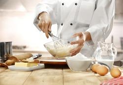 making cake in kitchen