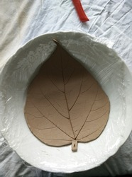 Making clay trays in the shape of leaves